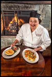 Chef Morejon with her Shepherd's Pie and Chicken Schnitzel © Chester Simpson