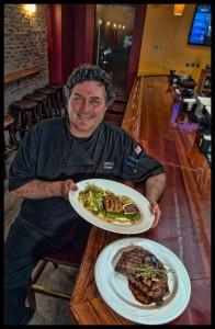 Chef Edwards with his 16 oz USDA Prime Rib Eye Steak and House Cured Pork Belly.