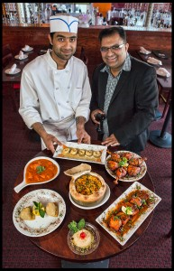 Chef Madhu and Owner.Mgr. Asad Sheikh Food - (Clockwise from top) Dahi Poori, Tandoori Chicken, Tandoori Salmon, Khulfi, Samosa, and (center) Biryani Chicken, Lamb, Goat, Shrimp, baked in the oven. © Chester Simpson